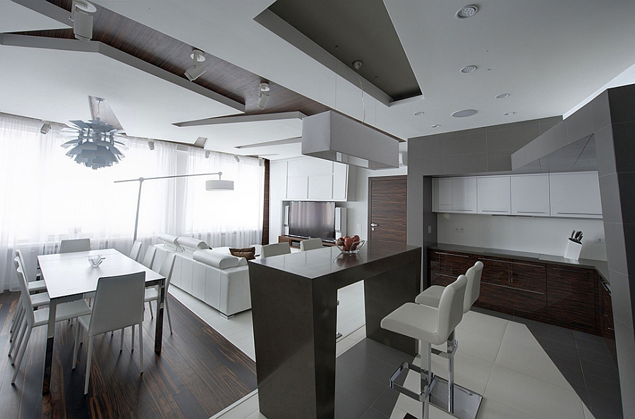 Laminated panels offer contrast to the white backdrop Remarkable Apartment In Moscow Combines Minimalism With Frugality!