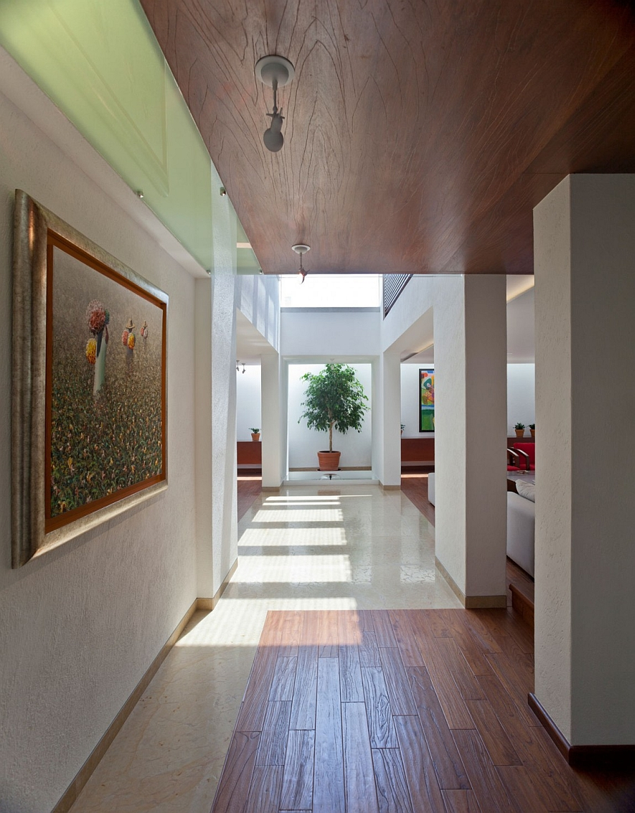 Large artwork display at the entrance Stylish Contemporary Residence Exudes Sleek Elegance And Inviting Warmth