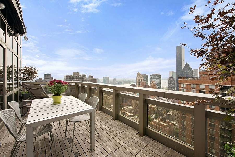 Large terrace with views of East River and New York City Skyline