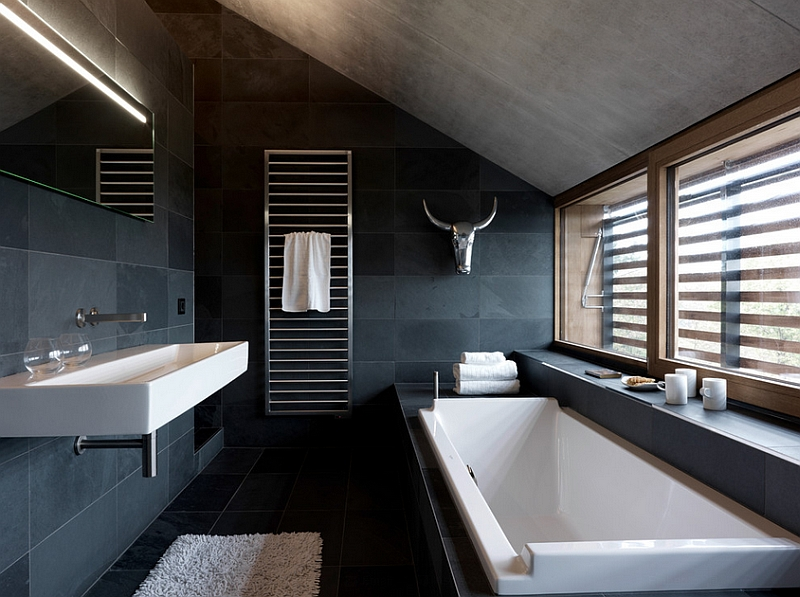 Lighting plays a pivotal role in defining the black and white bathroom