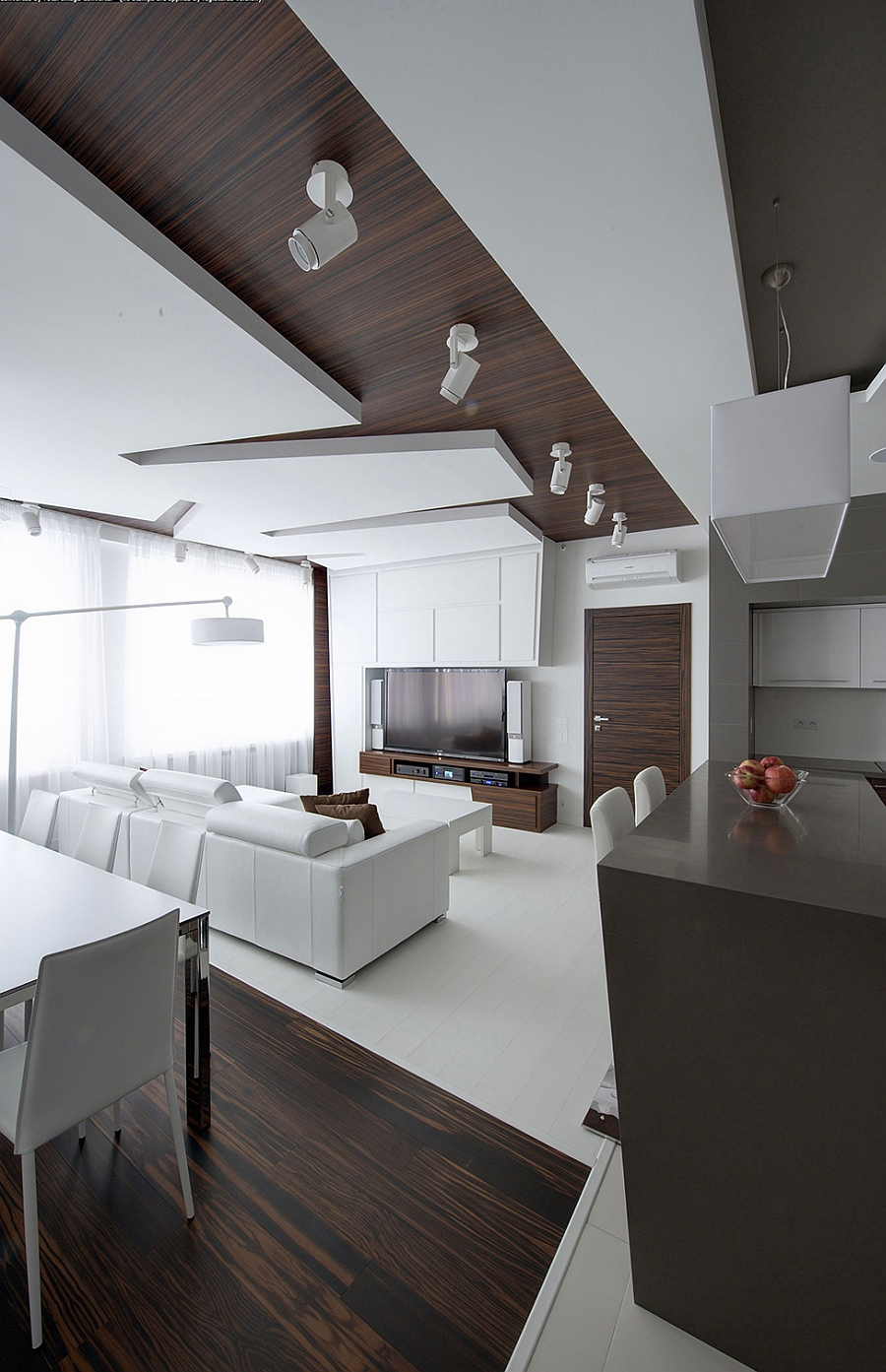 Minimal living space in white with wooden accents