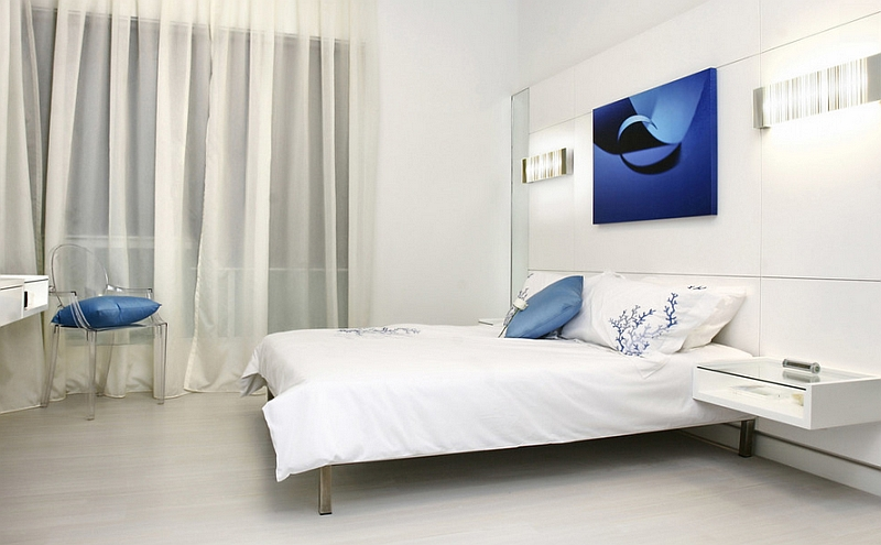 Minimalist bedroom in white with blue accents