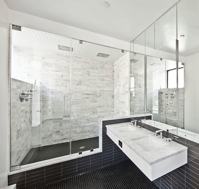 Mirrors lend visual lightness to the small bath