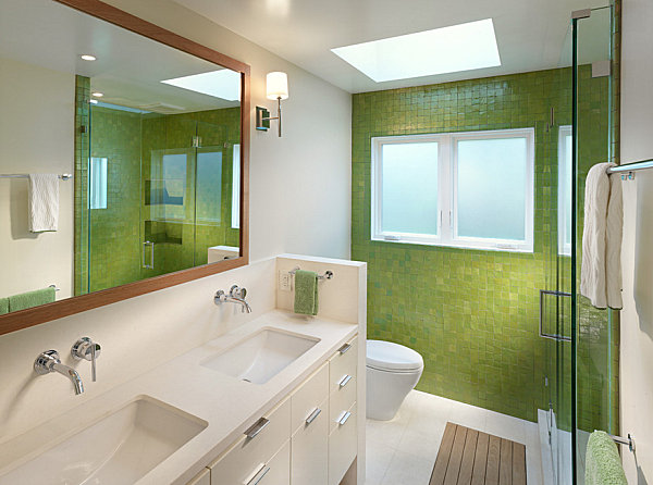Modern bathroom with green tile and towels