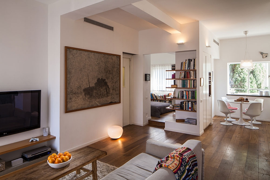 Open floor living room and kitchen Small Apartment In Tel Aviv Gets A Trendy Modern Makeover