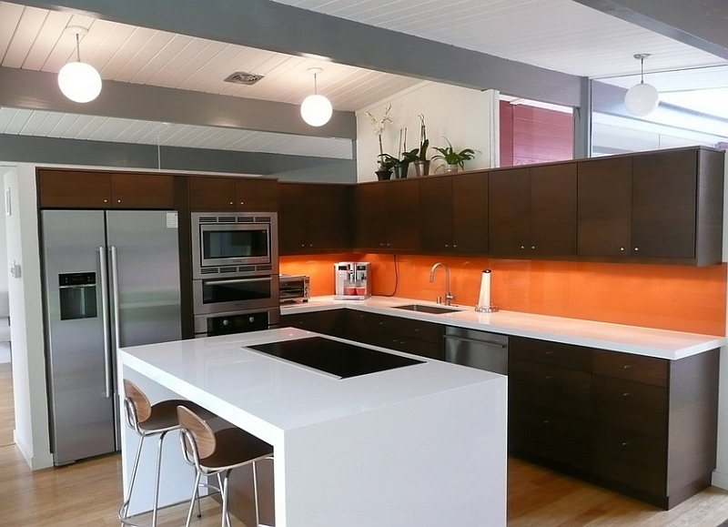 Orange is more at home in contemporary and retro kitchens