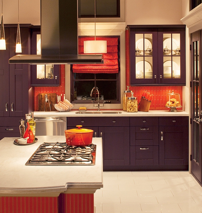 Orange subway tile makes up the backsplash in this kitchen