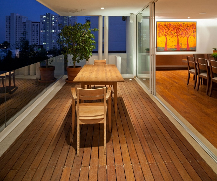 Outdoor wooden deck with small seating space