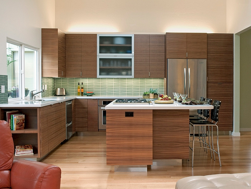 Pattern of the backsplash tiles seem to complement the wooden cabinets perfectly