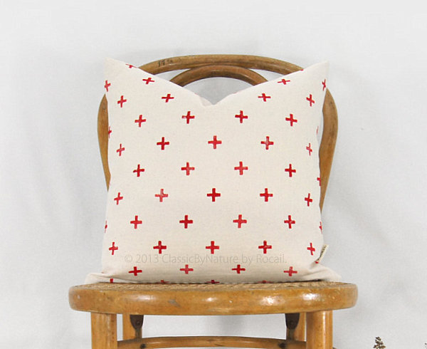 Pillow with a red cross motif