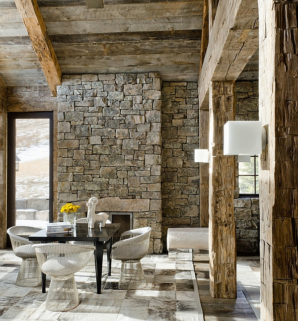 Platner arm chairs used as dining room chairs in this rustic home
