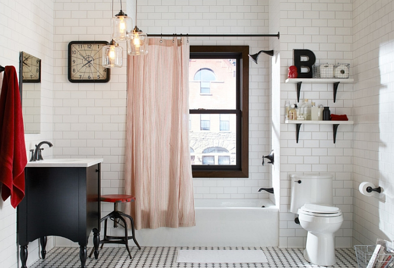Pops of red in the beautiful black and white bathroom