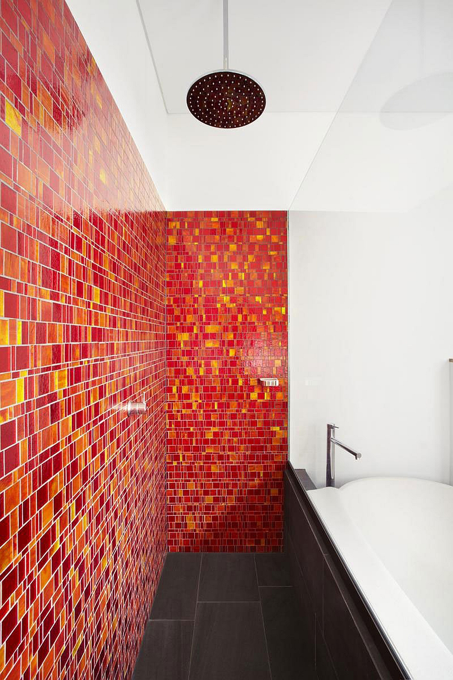 Red and yellow tiles for a lively bathroom