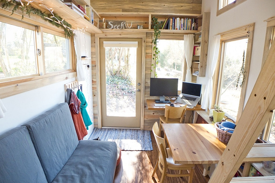 Seating space and workstation inside compact mobile house