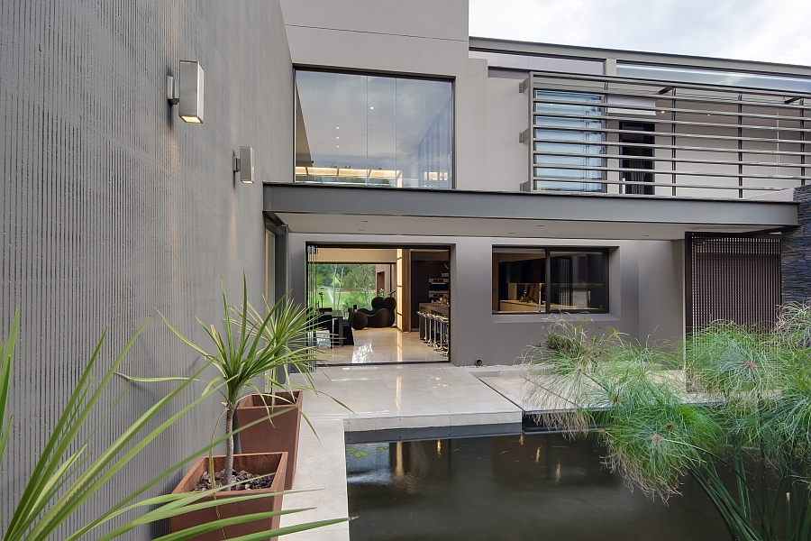 Dramatic contemporary residence amazes with stunning for Contemporary koi pond design