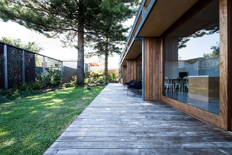 Simple wooden deck leading to the green backyard