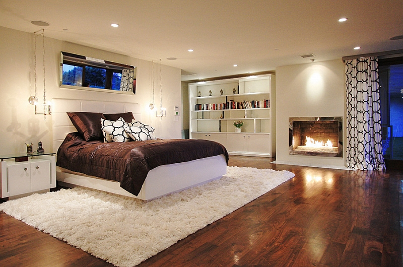 Spacious and stylish basement bedroom with fireplace