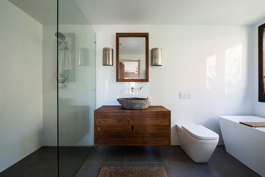 Stone sink stands out in the contemporary bathroom