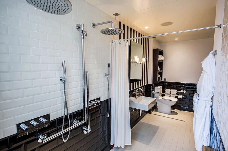 Stripes coupled with tiles in this simple black and white bathroom