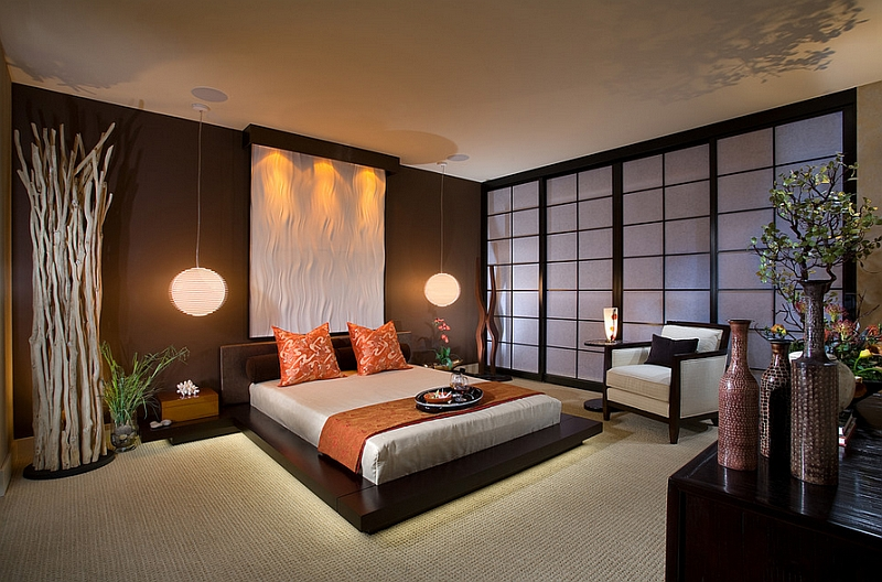 Stunning Asian style bedroom with platform bed and pendant lights