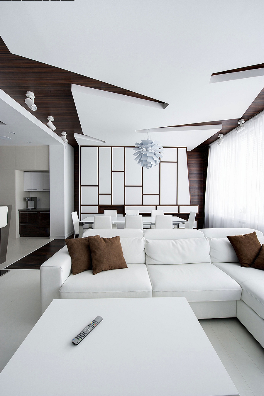 Stylish sectional sofa with the dining area behind it