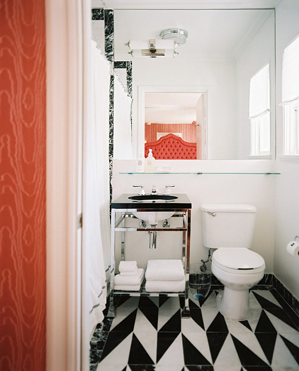 Stylish small bathroom with under-sink shelving