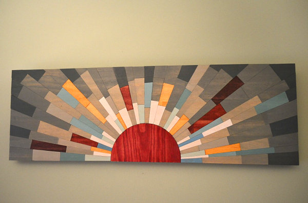 Sun-themed wall art from Etsy shop Stains and Grains