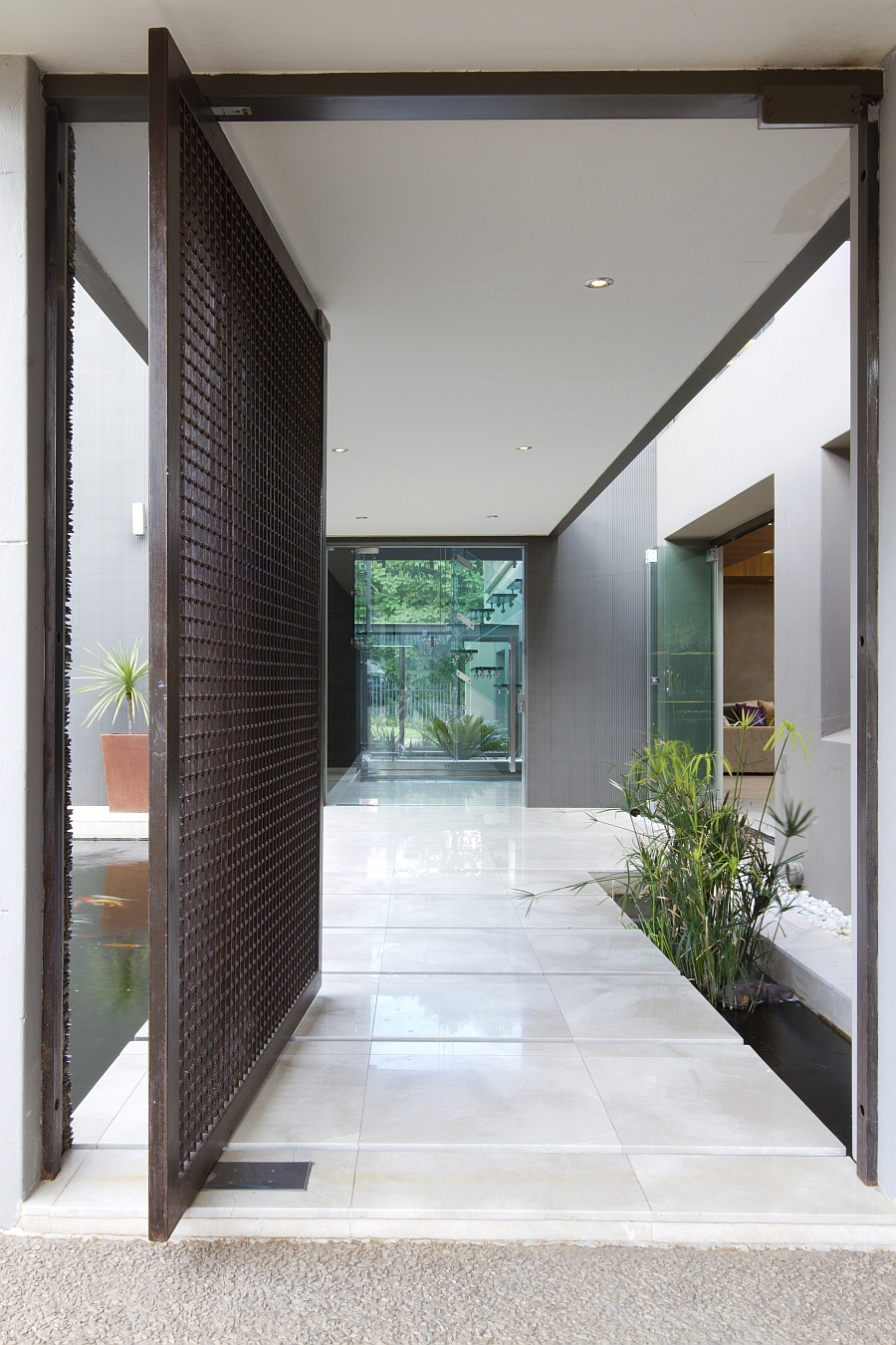 Dramatic Contemporary Residence Amazes With Stunning ... on Modern Entrance Design  id=90065