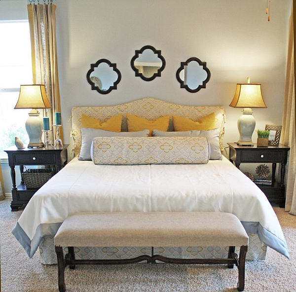 Table lamps accentuate the golden yellow shades in the bedroom