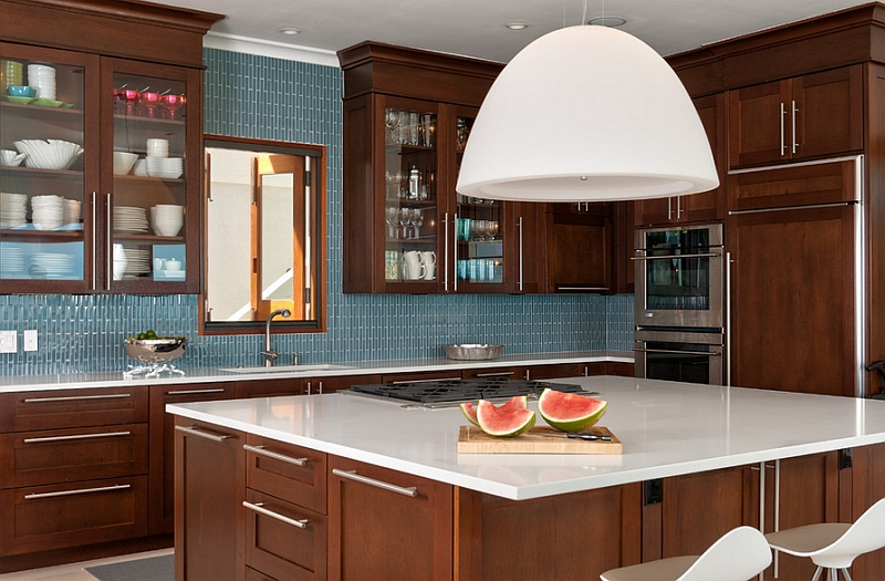 The blue backsplash can be paired with a wide range of colors