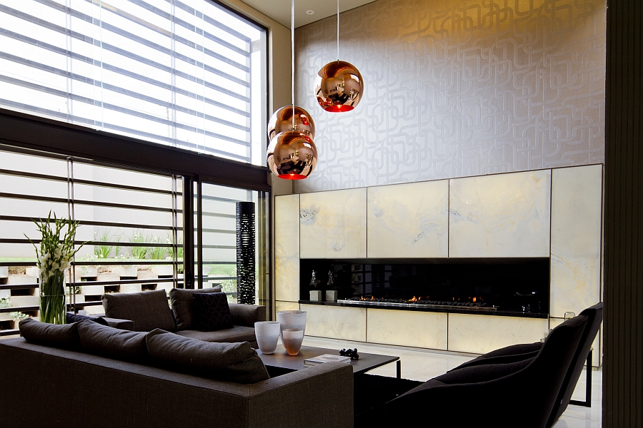 Tom Dixon pendant lights in the stunning living room
