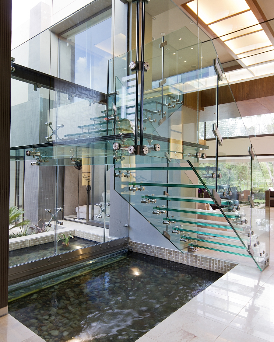 Transparent staircase design lends airiness to the space