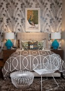 Turquoise lamps blend in with the feathery theme of the room