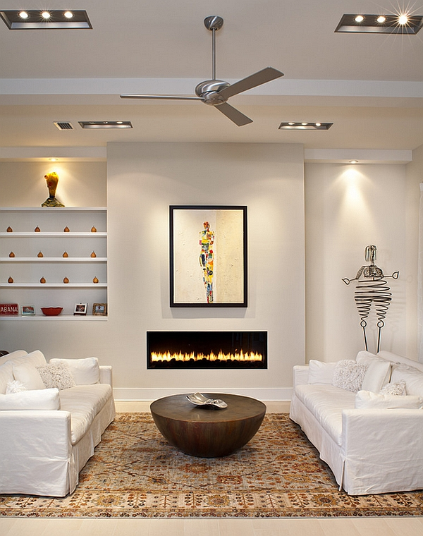 Unusual coffee table coupled with a sleek fireplace
