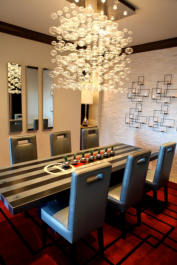 Wall sconce fixture in the backdrop complements the cascading chandelier elegantly