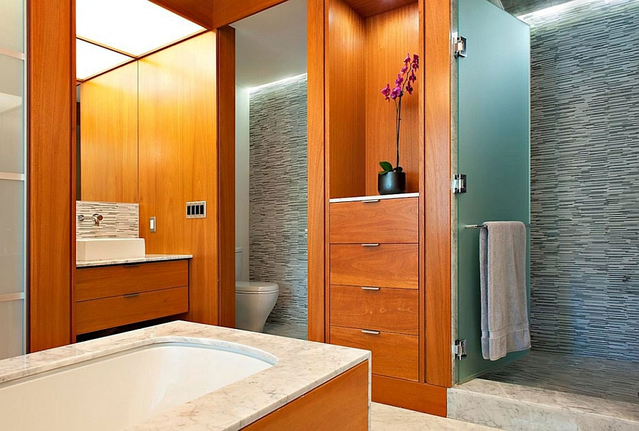 Warm wooden accents in the modern bathroom