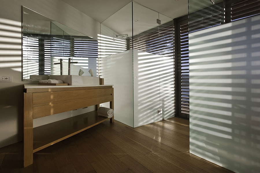 Wooden vanity and glass shower cubicle