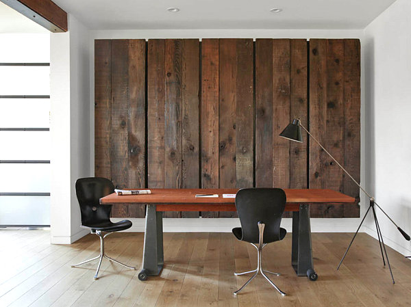 Wooden wall art conceals a murphy bed