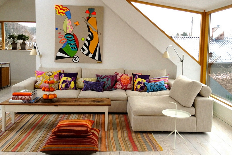 A cozy sofa filled with accent pillows