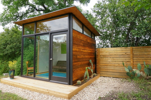 A tiny house next to a cedar fence The Art Of Building A Tiny House On A Budget