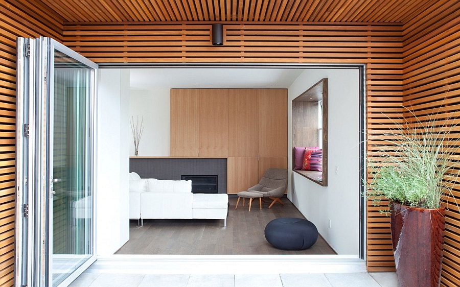 Access to the deck from the living area using glass doors