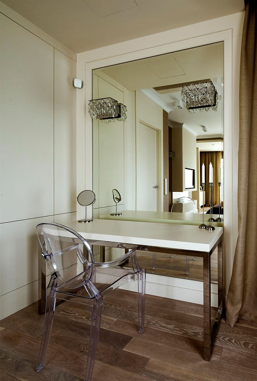 Acrylic chairs and wall sconces for visually airy interiors