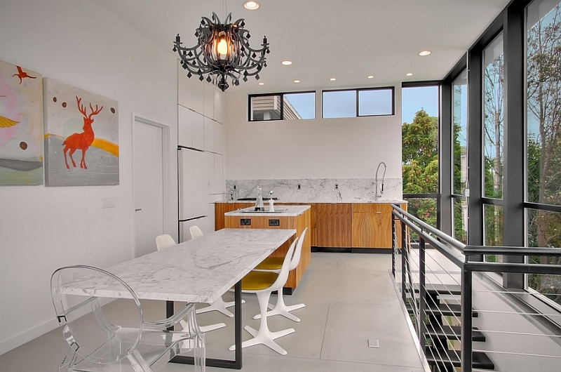 Acrylic chairs lend visual airiness to the dining space