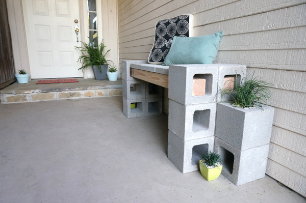 Add pillows to the cinder block bench to soften the look