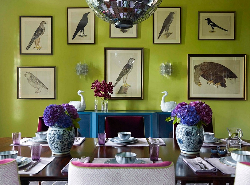 Antique Swedish bird prints set in a dining room with bold color