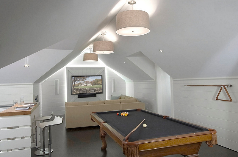 Attic game room with a neutral color scheme