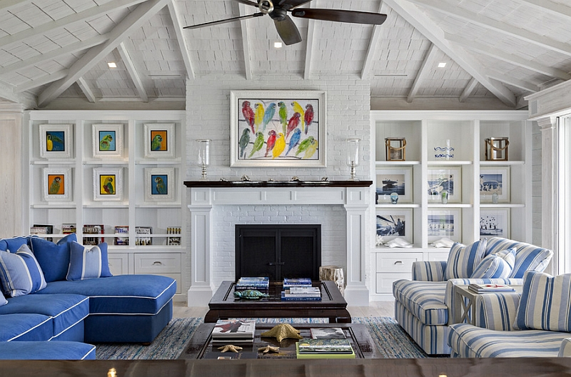Beach style living room with multi-colored wall art