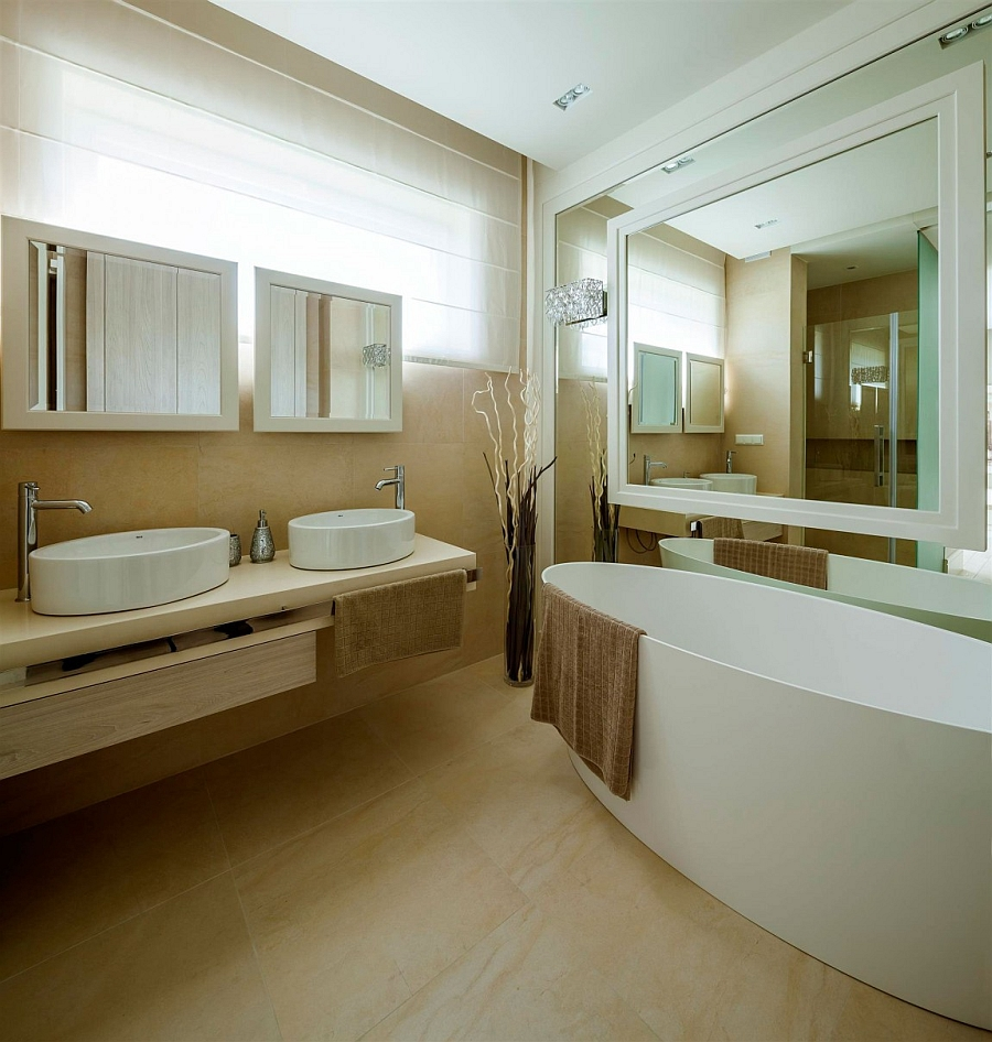 Beautiful modern bathroom in cream and white with floor vase