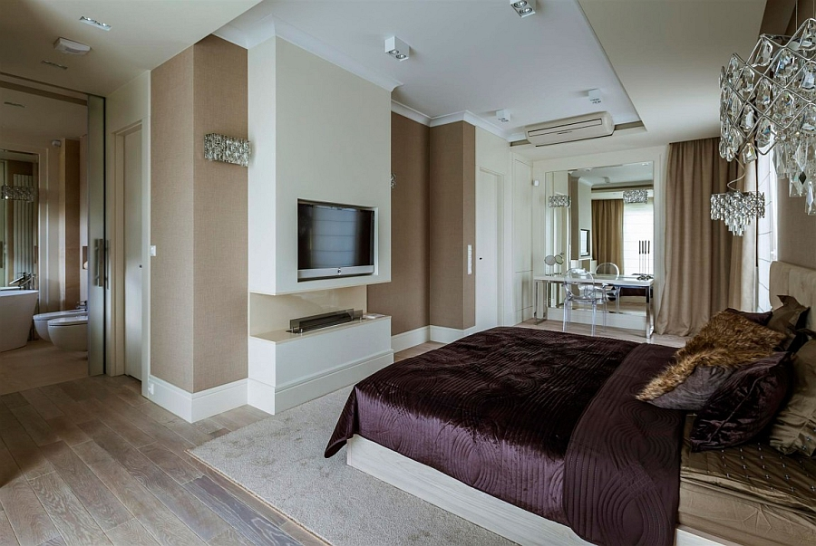 Bedroom TV above the sleek, contemporary fireplace