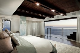 Bedroom with sheer curtains and dramatic Ocean Views
